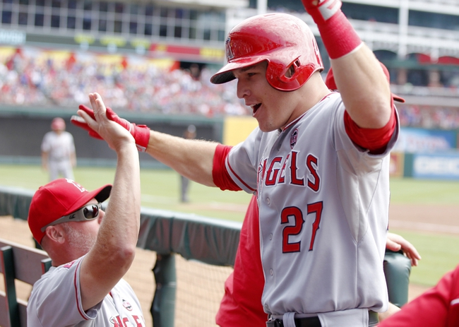 Sep 29, 2013; Arlington, TX, USA; Los Angeles Angels center fielder Mike Trout (27) celebrates hitting a home run in the first inning of the game against the Texas Rangers at Rangers Ballpark in Arlington. Mandatory Credit: Tim Heitman-USA TODAY Sports