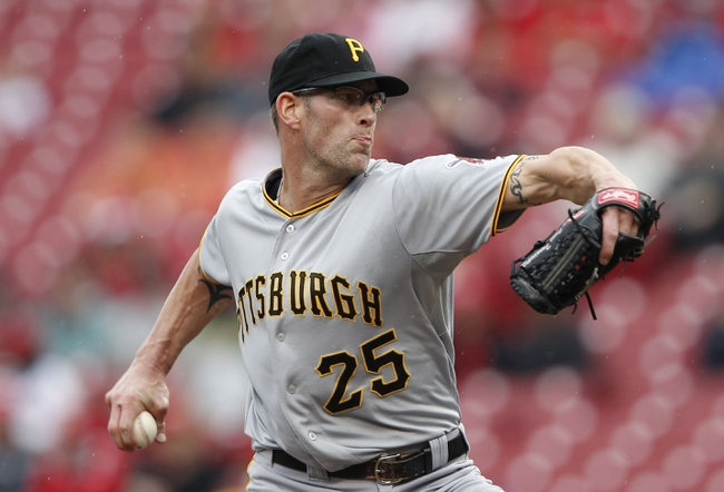 Sep 29, 2013; Cincinnati, OH, USA; Pittsburgh Pirates relief pitcher Kyle Farnsworth (25) pitches during the ninth inning against the Cincinnati Reds at Great American Ball Park. The Pirates defeated the Reds 4-2. Mandatory Credit: Frank Victores-USA TODAY Sports