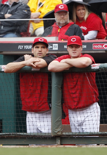 Sep 29, 2013; Cincinnati, OH, USA; Cincinnati Reds right fielder Jay Bruce (right) and first baseman Joey Votto (left) watch the ninth inning against the Pittsburgh Pirates at Great American Ball Park. The Pirates defeated the Reds 4-2. Mandatory Credit: Frank Victores-USA TODAY Sports