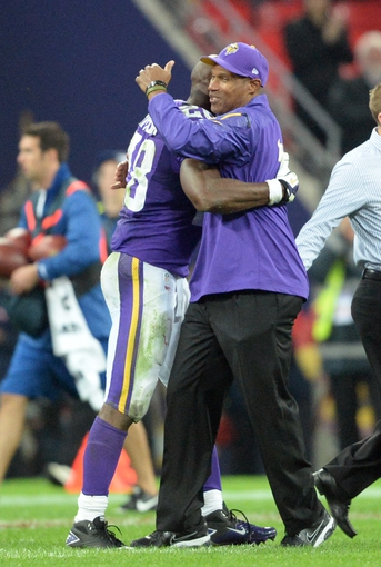 Sep 29, 2013; London, UNITED KINGDOM; Minnesota Vikings head coach Leslie Frazier hugs running back Adrian Peterson (28) after the NFL International Series game against the Pittsburgh Steelers at Wembley Stadium. Mandatory Credit: Bob Martin-USA TODAY Sports