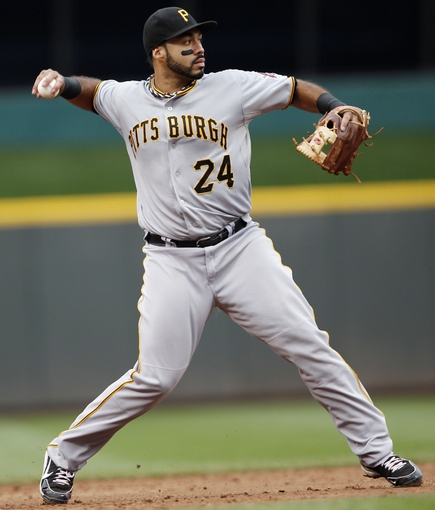 Sep 29, 2013; Cincinnati, OH, USA; Pittsburgh Pirates third baseman Pedro Alvarez (24) makes a play during the second inning against the Cincinnati Reds at Great American Ball Park. Mandatory Credit: Frank Victores-USA TODAY Sports