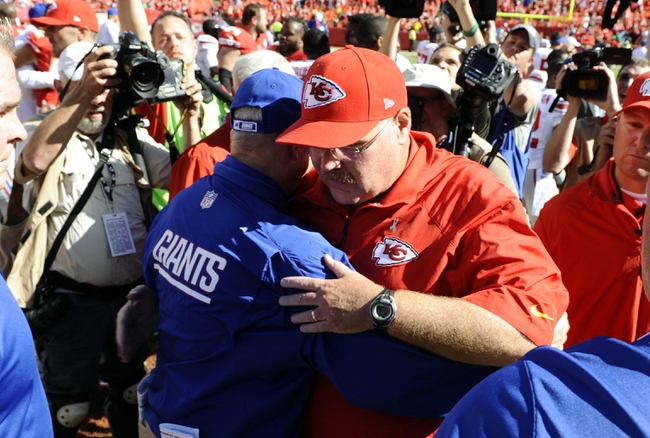 Sep 29, 2013; Kansas City, MO, USA; New York Giants head coach Tom Coughlin (left) talks to Kansas City Chiefs head coach Andy Reid (right) after the game at Arrowhead Stadium. Kansas City won the game 31-7. Mandatory Credit: John Rieger-USA TODAY Sports