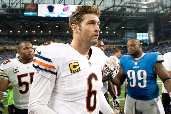 Sep 29, 2013; Detroit, MI, USA; Chicago Bears quarterback Jay Cutler (6) walks of the field after the game against the Detroit Lions at Ford Field. The Lions won 40-32. Mandatory Credit: Tim Fuller-USA TODAY Sports