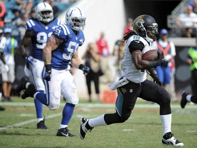 Sep 29, 2013; Jacksonville, FL, USA; Jacksonville Jaguars wide receiver Ace Sanders (18) runs the ball for a large gain past Indianapolis Colts inside linebacker Pat Angerer (51) during the second half of the game against the Jacksonville Jaguars at EverBank Field. Mandatory Credit: Melina Vastola-USA TODAY Sports