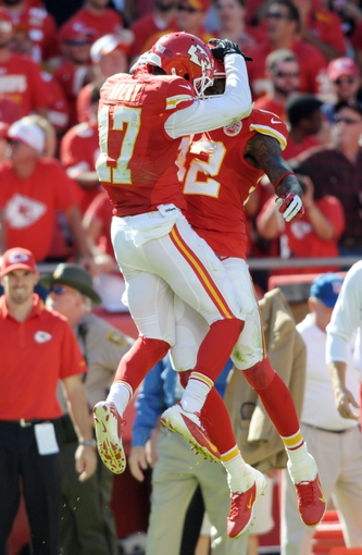 Sep 29, 2013; Kansas City, MO, USA; Kansas City Chiefs wide receiver Dwayne Bowe (82) is congratulated by wide receiver Donnie Avery (17) after Bowe scores a touchdown during the second half of the game against the New York Giants at Arrowhead Stadium. The Chiefs won 31-7. Mandatory Credit: Denny Medley-USA TODAY Sports