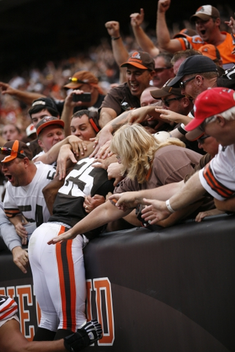 Sep 29, 2013; Cleveland, OH, USA; Cleveland Browns running back Chris Ogbonnaya (25) celebrates by jumping into the crowd after scoring a touchdown during the fourth quarter against the Cincinnati Bengals at FirstEnergy Stadium. Browns beat the Bengals 17-6. Mandatory Credit: Raj Mehta-USA TODAY Sports