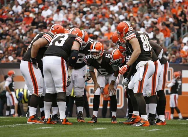 Sep 29, 2013; Cleveland, OH, USA; Cleveland Browns quarterback Brian Hoyer (6) calls a play in the huddle during the third quarter against the Cincinnati Bengals at FirstEnergy Stadium. Browns beat the Bengals 17-6. Mandatory Credit: Raj Mehta-USA TODAY Sports