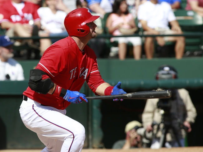 Sep 29, 2013; Arlington, TX, USA; Texas Rangers designated hitter A.J. Pierzynski (12) watches a ball that lands for a double in the fifth inning of the game against the Los Angeles Angels at Rangers Ballpark in Arlington. Mandatory Credit: Tim Heitman-USA TODAY Sports