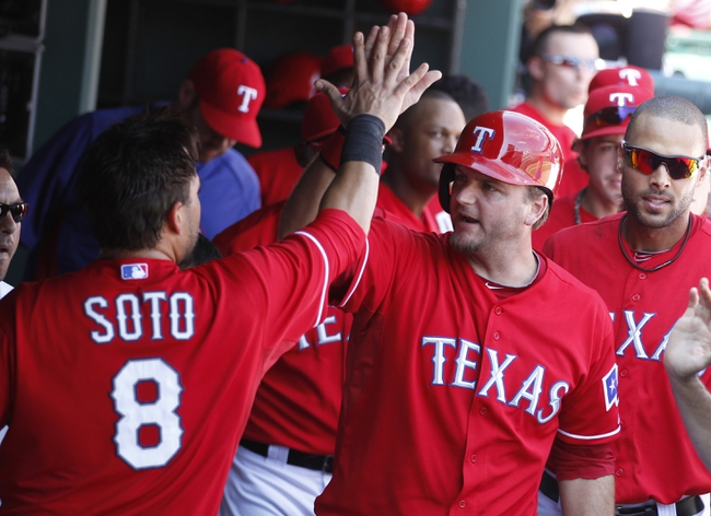 Sep 29, 2013; Arlington, TX, USA; Texas Rangers designated hitter A.J. Pierzynski (12) high fives catcher Geovany Soto (8) after they scored runs in the bottom of the fifth inning against the Los Angeles Angels at Rangers Ballpark in Arlington. Mandatory Credit: Tim Heitman-USA TODAY Sports