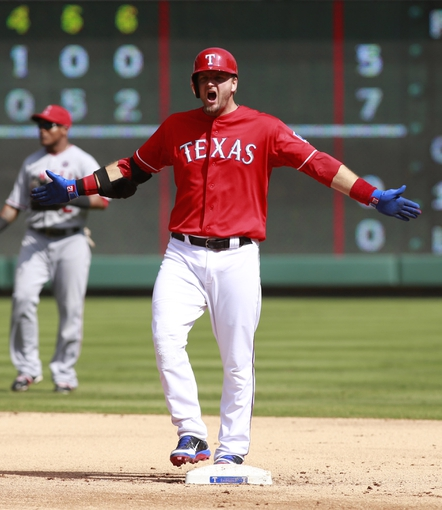 Sep 29, 2013; Arlington, TX, USA; Texas Rangers designated hitter A.J. Pierzynski (12) reacts to hitting a double in the fifth inning of the game against the Los Angeles Angels at Rangers Ballpark in Arlington. Mandatory Credit: Tim Heitman-USA TODAY Sports