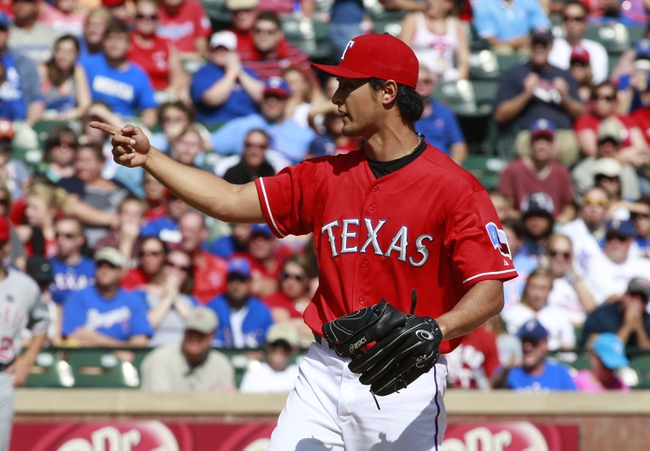 Sep 29, 2013; Arlington, TX, USA; Texas Rangers starting pitcher Yu Darvish (11) reacts to a called third strike in the fifth inning of the game against the Los Angeles Angels at Rangers Ballpark in Arlington. Mandatory Credit: Tim Heitman-USA TODAY Sports