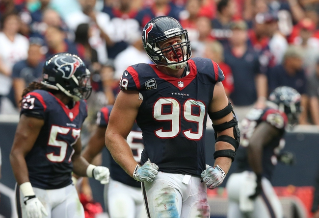 Sep 29, 2013; Houston, TX, USA; Houston Texans defensive end J.J. Watt (99) reacts in the fourth quarter as blood drips down from his nose against the Seattle Seahawks at Reliant Stadium. The Seattle Seahawks beat the Houston Texans 23-20. Mandatory Credit: Matthew Emmons-USA TODAY Sports