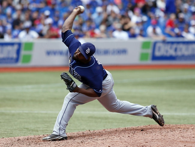 Sep 29, 2013; Toronto, Ontario, CAN; Tampa Bay Rays pitcher Fernando Rodney (56) throws against the Toronto Blue Jays in the ninth inning at Rogers Centre. Tampa defeated Toronto 7-6. Mandatory Credit: John E. Sokolowski-USA TODAY Sports