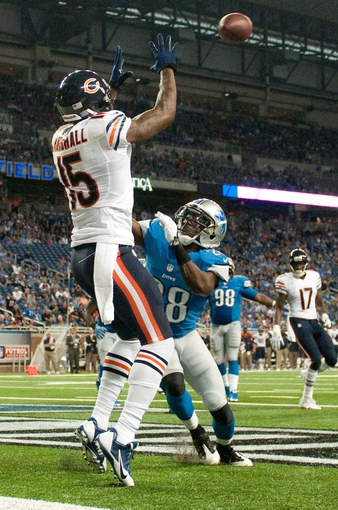 Sep 29, 2013; Detroit, MI, USA; Chicago Bears wide receiver Brandon Marshall (15) completes a two point conversion while being pressured by Detroit Lions cornerback Bill Bentley (28) during the fourth quarter at Ford Field. The Lions won 40-32. Mandatory Credit: Tim Fuller-USA TODAY Sports