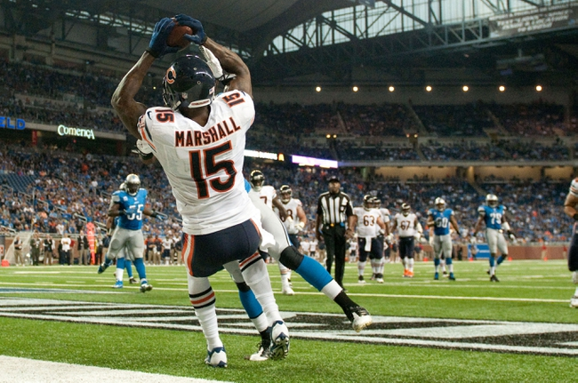 Sep 29, 2013; Detroit, MI, USA; Chicago Bears wide receiver Brandon Marshall (15) completes a two point conversion during the fourth quarter against the Detroit Lions at Ford Field. The Lions won 40-32. Mandatory Credit: Tim Fuller-USA TODAY Sports