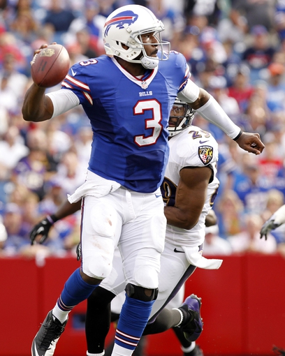 Sep 29, 2013; Orchard Park, NY, USA; Buffalo Bills quarterback EJ Manuel (3) rolls out and is chased by Baltimore Ravens free safety Michael Huff (29) during the second half at Ralph Wilson Stadium. Bills beat the Ravens 23-20. Mandatory Credit: Kevin Hoffman-USA TODAY Sports