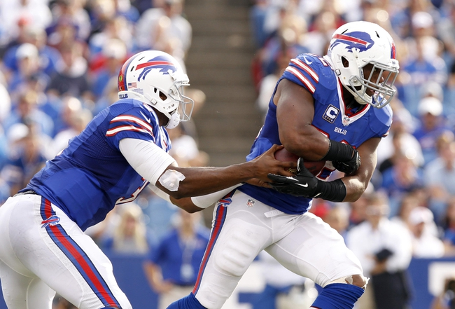 Sep 29, 2013; Orchard Park, NY, USA; Buffalo Bills quarterback EJ Manuel (3) fakes a handoff to running back Fred Jackson (22) during the second half against the Baltimore Ravens at Ralph Wilson Stadium. Bills beat the Ravens 23-20. Mandatory Credit: Kevin Hoffman-USA TODAY Sports