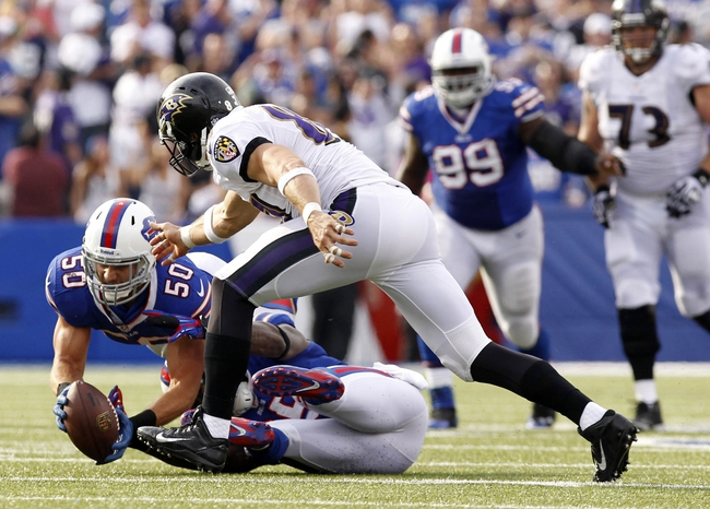 Sep 29, 2013; Orchard Park, NY, USA; Buffalo Bills middle linebacker Kiko Alonso (50) intercepts a pass in front of Baltimore Ravens tight end Dallas Clark (87) during the second half at Ralph Wilson Stadium. Bills beat the Ravens 23-20. Mandatory Credit: Kevin Hoffman-USA TODAY Sports