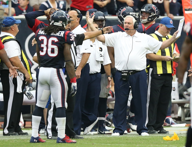 Sep 29, 2013; Houston, TX, USA; Houston Texans defensive coordinator Wade Phillips reacts to an unnecessary roughness call in overtime against the Seattle Seahawks at Reliant Stadium. The Seattle Seahawks beat the Houston Texans 23-20 in overtime. Mandatory Credit: Matthew Emmons-USA TODAY Sports