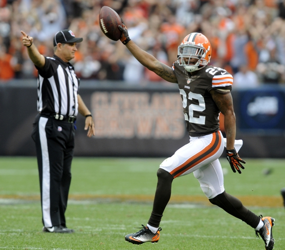 Sep 29, 2013; Cleveland, OH, USA; Cleveland Browns cornerback Buster Skrine (22) celebrates his fourth quarter interception against the Cincinnati Bengals at FirstEnergy Stadium. The Browns beat the Bengals 17-6. Mandatory Credit: Ken Blaze-USA TODAY Sports