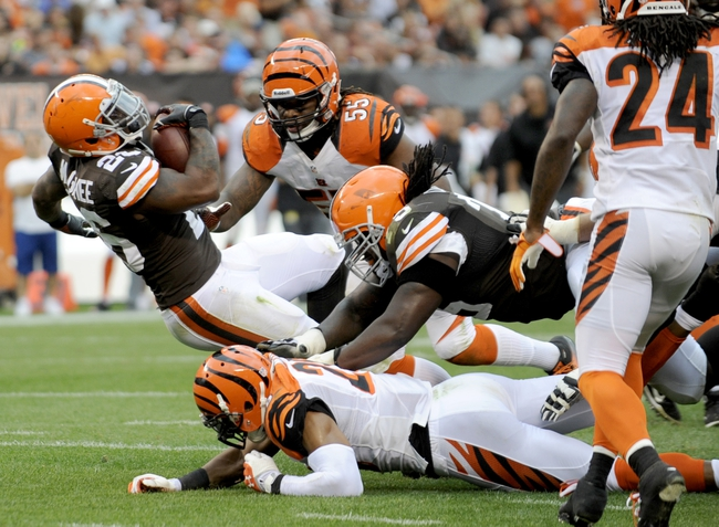 Sep 29, 2013; Cleveland, OH, USA; Cleveland Browns running back Willis McGahee lunges for the end zone against the Cincinnati Bengals during the fourth quarter at FirstEnergy Stadium. The Browns beat the Bengals 17-6. Mandatory Credit: Ken Blaze-USA TODAY Sports