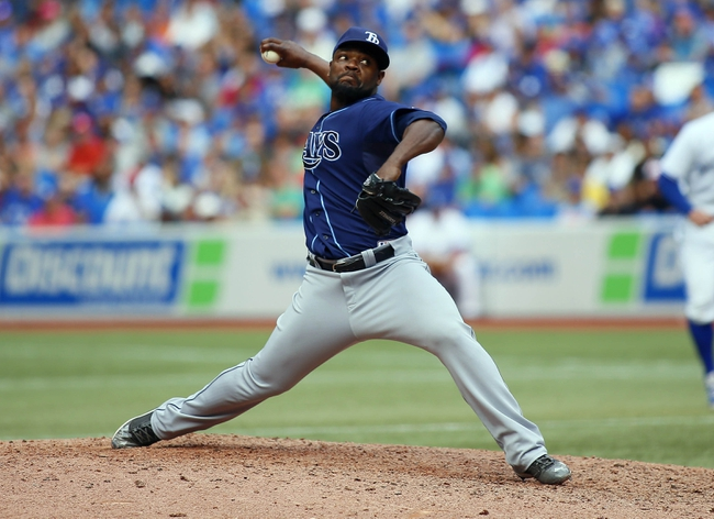 Sep 29, 2013; Toronto, Ontario, CAN; Tampa Bay Rays pitcher Fernando Rodney (56) throws against the Toronto Blue Jays at Rogers Centre. Tampa defeated Toronto 7-6. Mandatory Credit: John E. Sokolowski-USA TODAY Sports