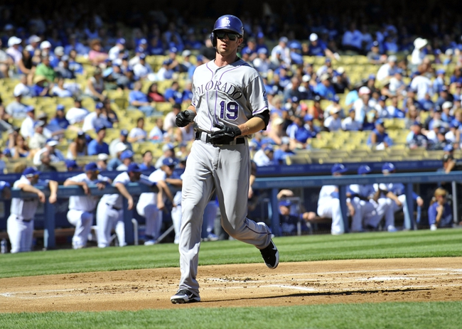 September 29, 2013; Los Angeles, CA, USA; Colorado Rockies right fielder Charlie Blackmon (19) scores a run in the first inning against the Los Angeles Dodgers at Dodger Stadium. Mandatory Credit: Gary A. Vasquez-USA TODAY Sports