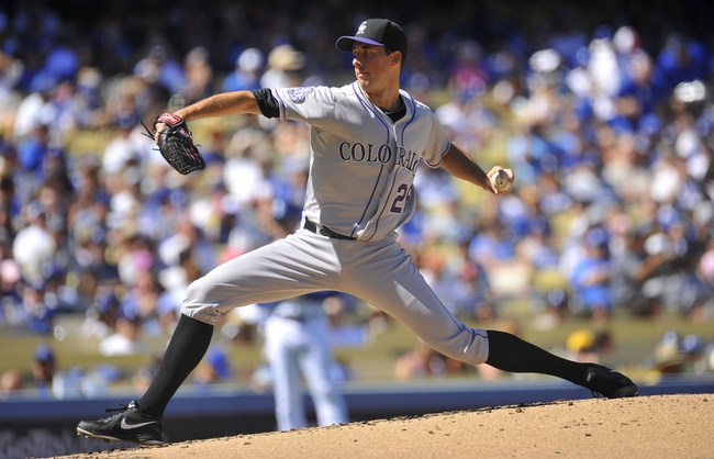 September 29, 2013; Los Angeles, CA, USA; Colorado Rockies starting pitcher Jeff Francis (26) pitches during the second inning against the Los Angeles Dodgers at Dodger Stadium. Mandatory Credit: Gary A. Vasquez-USA TODAY Sports