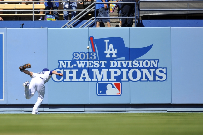 September 29, 2013; Los Angeles, CA, USA; Los Angeles Dodgers second baseman Skip Schumaker (55) misses catching a fly ball during the first inning against the Colorado Rockies at Dodger Stadium. Mandatory Credit: Gary A. Vasquez-USA TODAY Sports