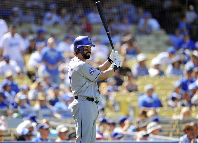 September 29, 2013; Los Angeles, CA, USA; Colorado Rockies first baseman Todd Helton (17) on deck before coming up to hit in the second inning against the Los Angeles Dodgers at Dodger Stadium. Mandatory Credit: Gary A. Vasquez-USA TODAY Sports
