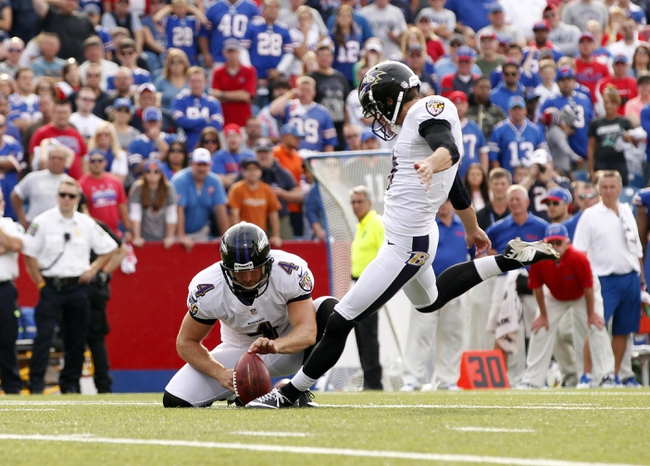 Sep 29, 2013; Orchard Park, NY, USA; Baltimore Ravens punter Sam Koch (4) holds as kicker Justin Tucker (9) kicks a field goal against the Buffalo Bills during the second half at Ralph Wilson Stadium. Bills beat the Ravens 23-20. Mandatory Credit: Kevin Hoffman-USA TODAY Sports