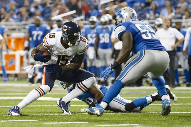 Sep 29, 2013; Detroit, MI, USA; Chicago Bears wide receiver Brandon Marshall (15) runs with the ball at Detroit Lions middle linebacker Stephen Tulloch (55) in the fourth quarter at Ford Field. The Lions won 40-32. Mandatory Credit: Rick Osentoski-USA TODAY Sports
