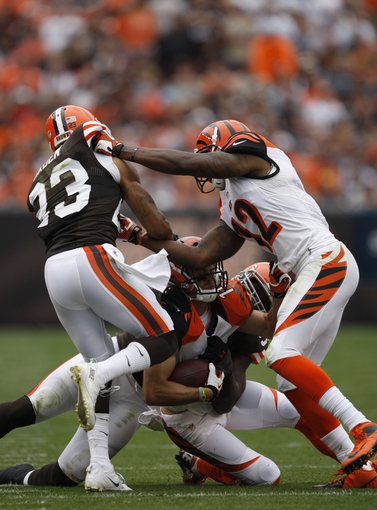 Sep 29, 2013; Cleveland, OH, USA; Cincinnati Bengals wide receiver Dane Sanzenbacher (11) gets tackled by the Cleveland Browns defense during the third quarter at FirstEnergy Stadium. Browns beat the Bengals 17-6. Mandatory Credit: Raj Mehta-USA TODAY Sports