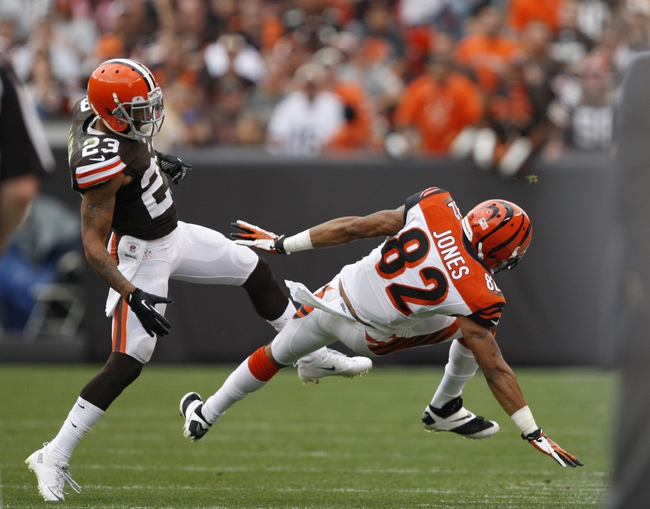 Sep 29, 2013; Cleveland, OH, USA; Cleveland Browns cornerback Joe Haden (23) and Cincinnati Bengals wide receiver Marvin Jones (82) collide during the fourth quarter at FirstEnergy Stadium. Browns beat the Bengals 17-6. Mandatory Credit: Raj Mehta-USA TODAY Sports