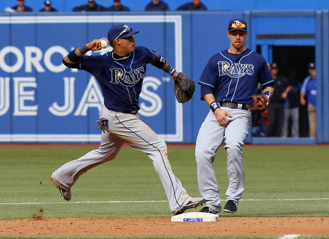Sep 29, 2013; Toronto, Ontario, CAN; Tampa Bay Rays shortstop Yunel Escobar (11) turns a double play against the Toronto Blue Jays in the seventh inning at Rogers Centre. Tampa defeated Toronto 7-6. Mandatory Credit: John E. Sokolowski-USA TODAY Sports