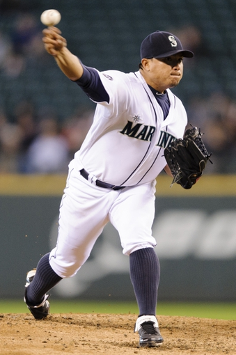 Sep 29, 2013; Seattle, WA, USA; Seattle Mariners starting pitcher Erasmo Ramirez (50) pitches to the Oakland Athletics during the second inning at Safeco Field. Mandatory Credit: Steven Bisig-USA TODAY Sports