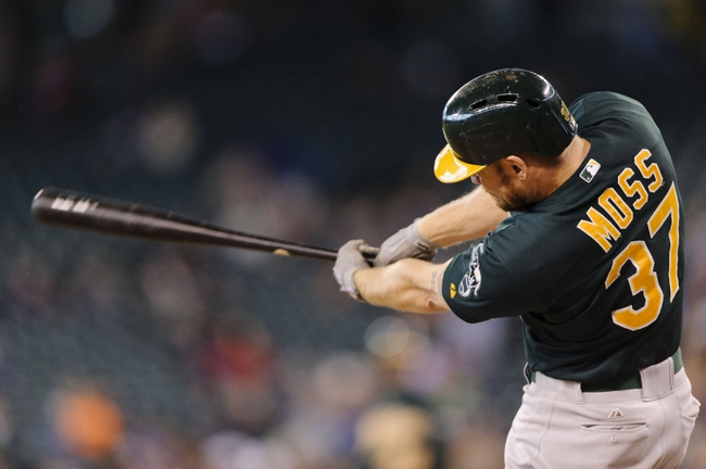 Sep 29, 2013; Seattle, WA, USA; Oakland Athletics designated hitter Brandon Moss  (37) hits a RBI double against the Seattle Mariners during the second inning at Safeco Field. Mandatory Credit: Steven Bisig-USA TODAY Sports