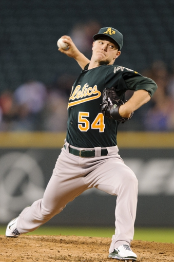 Sep 29, 2013; Seattle, WA, USA; Oakland Athletics starting pitcher Sonny Gray (54) pitches to the Seattle Mariners during the first inning at Safeco Field. Mandatory Credit: Steven Bisig-USA TODAY Sports