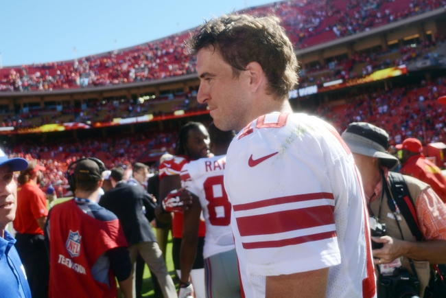 Sep 29, 2013; Kansas City, MO, USA; New York Giants quarterback Eli Manning (10) walks off the field after the game against the Kansas City Chiefs at Arrowhead Stadium. The Chiefs won 31-7. Mandatory Credit: Denny Medley-USA TODAY Sports