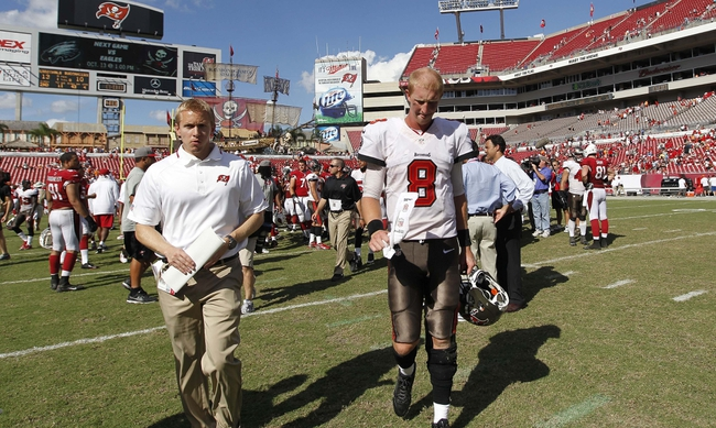 Sep 29, 2013; Tampa, FL, USA; Tampa Bay Buccaneers quarterback Mike Glennon (8) reacts as he walks back to the locker room after the game against the Arizona Cardinals at Raymond James Stadium. Arizona Cardinals defeated the Tampa Bay Buccaneers 13-10. Mandatory Credit: Kim Klement-USA TODAY Sports