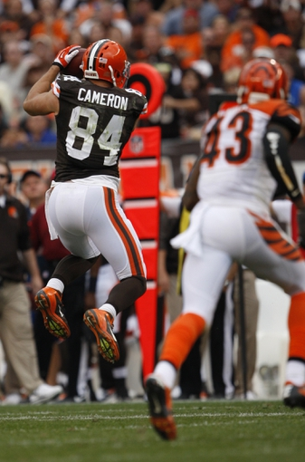 Sep 29, 2013; Cleveland, OH, USA; Cleveland Browns tight end Jordan Cameron (84) make a catch during the fourth quarter against the Cincinnati Bengals at FirstEnergy Stadium. Browns beat the Bengals 17-6. Mandatory Credit: Raj Mehta-USA TODAY Sports