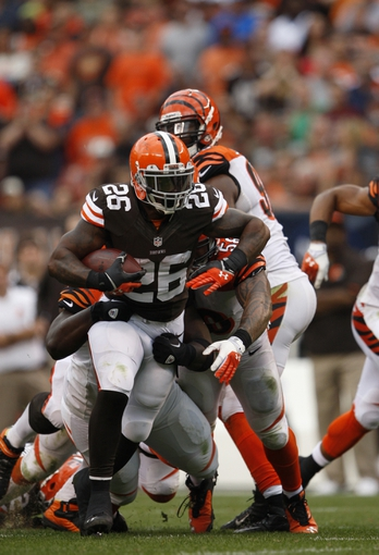 Sep 29, 2013; Cleveland, OH, USA; Cleveland Browns running back Willis Mcgahee runs the ball during the fourth quarter against the Cincinnati Bengals at FirstEnergy Stadium. Browns beat the Bengals 17-6. Mandatory Credit: Raj Mehta-USA TODAY Sports