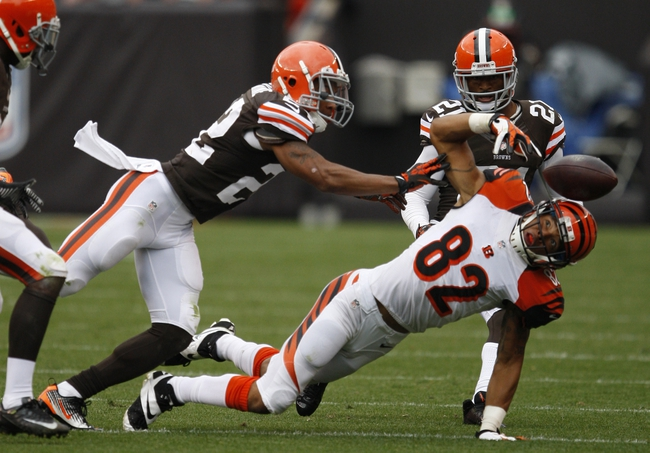 Sep 29, 2013; Cleveland, OH, USA; Cincinnati Bengals wide receiver Marvin Jones (82) misses a catch during the fourth quarter against the Cleveland Browns at FirstEnergy Stadium. Browns beat the Bengals 17-6. Mandatory Credit: Raj Mehta-USA TODAY Sports