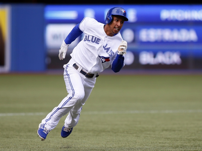 Sep 29, 2013; Toronto, Ontario, CAN; Toronto Blue Jays center fielder Anthony Gose (8)  heads for third base in the seventh inning against the Tampa Bay Rays at Rogers Centre. Tampa defeated Toronto 7-6. Mandatory Credit: John E. Sokolowski-USA TODAY Sports