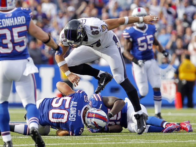 Sep 29, 2013; Orchard Park, NY, USA; Baltimore Ravens tight end Dallas Clark (87) watches as Buffalo Bills middle linebacker Kiko Alonso (50) makes a second half interception at Ralph Wilson Stadium. Bills beat Ravens 23 to 20.  Mandatory Credit: Timothy T. Ludwig-USA TODAY Sports