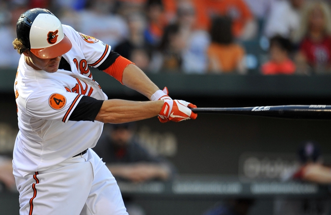 Sep 29, 2013; Baltimore, MD, USA; Baltimore Orioles third baseman Danny Valencia (35) swings the bat in the seventh inning against the Boston Red Sox at at Oriole Park at Camden Yards. The Orioles won 7-6. Mandatory Credit: Joy R. Absalon-USA TODAY Sports