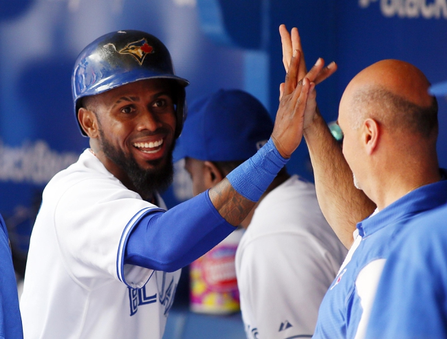 Sep 29, 2013; Toronto, Ontario, CAN; Toronto Blue Jays shortstop Jose Reyes (7) celebrates scoring in the seventh inning against the Tampa Bay Rays at Rogers Centre. Tampa defeated Toronto 7-6. Mandatory Credit: John E. Sokolowski-USA TODAY Sports