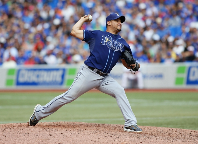 Sep 29, 2013; Toronto, Ontario, CAN; Tampa Bay Rays pitcher Joel Peralta (62) throws against the Toronto Blue Jays in the eighth inning at Rogers Centre. Tampa defeated Toronto 7-6. Mandatory Credit: John E. Sokolowski-USA TODAY Sports