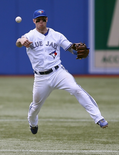 Sep 29, 2013; Toronto, Ontario, CAN; Toronto Blue Jays third baseman Brett Lawrie (13) throws out Tampa Bay Rays shortstop Yunel Escobar (not pictured) in the ninth inning at Rogers Centre. Tampa defeated Toronto 7-6. Mandatory Credit: John E. Sokolowski-USA TODAY Sports