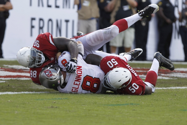 Sep 29, 2013; Tampa, FL, USA; Tampa Bay Buccaneers quarterback Mike Glennon (8) was sacked by Arizona Cardinals linebacker Dontay Moch (50) and defensive end Frostee Rucker (98) during the second half at Raymond James Stadium. Arizona Cardinals defeated the Tampa Bay Buccaneers 13-10. Mandatory Credit: Kim Klement-USA TODAY Sports